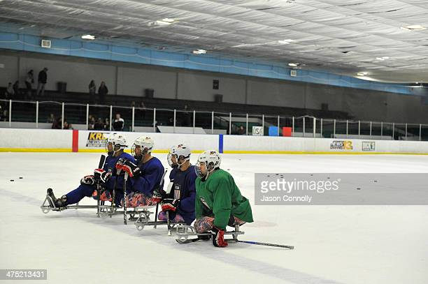 S Paralympic Sled Hockey Team athletes line up during a shooting drill while attending a team practice at the Sertich Ice Arena on February 26 2014...