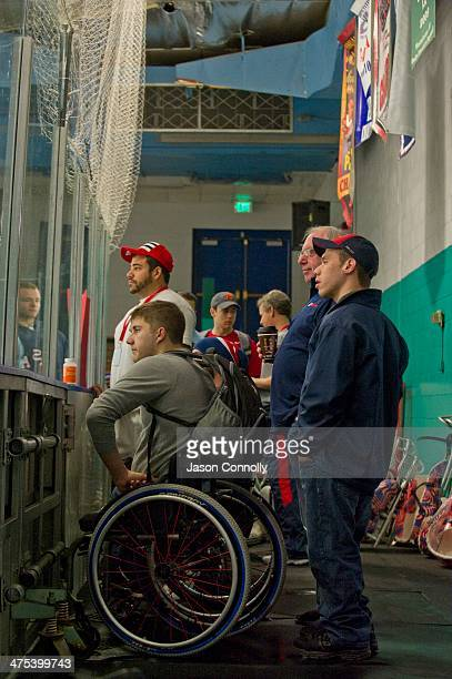 S Paralympic Sled Hockey Team athletes watch as the ice is prepared by a zamboni at the Sertich Ice Arena in Colorado Springs Colorado on February 27...