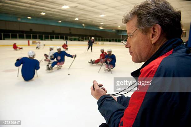 S Paralympic Sled Hockey Team Athletic Trainer Mike Cortese watches his stop watch as the team practices speed drills during the team's last US based...