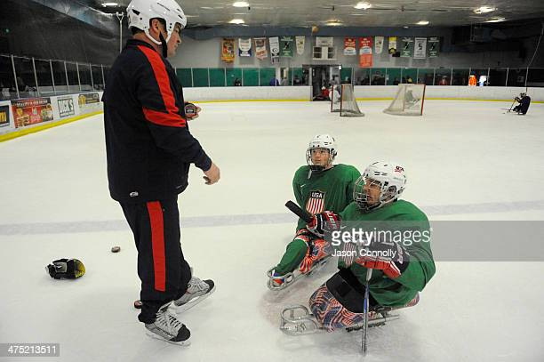 S Paralympic Sled Hockey Team General Manager Dan Brennan talks with US Paralympic Sled Hockey Team athletes Declan Farmer and Greg Shaw during...