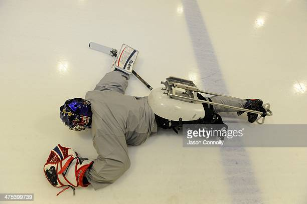S Paralympic Sled Hockey Team goalie Jen Yung Lee streches prior to the team's final US based practice at the Sertich Ice Arena in Colorado Springs...