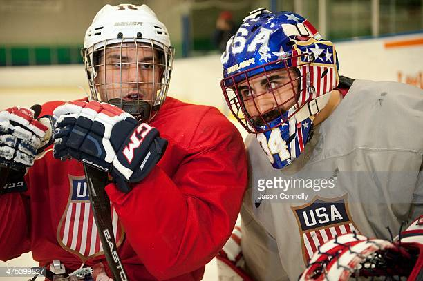 S Paralympic Sled Hockey Team goalie Steve Cash listens as teammate Kevin McKee discusses a shooting drill while attending practice at the Sertich...