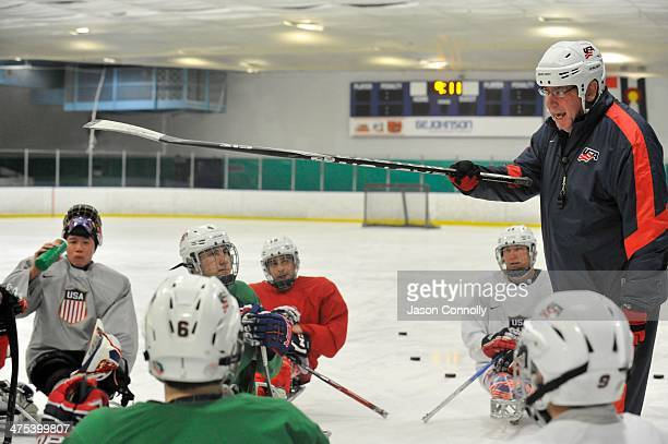 S Paralympic Sled Hockey Team Head Coach Jeff Sauer talks to his athletes during a team timeout while holding the team's final US based practice at...