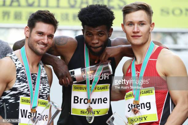 Paralympic sprinters Jarryd Wallace of the United States Richard Browne of the United States and Felix Streng of Germany pose for photographs during...