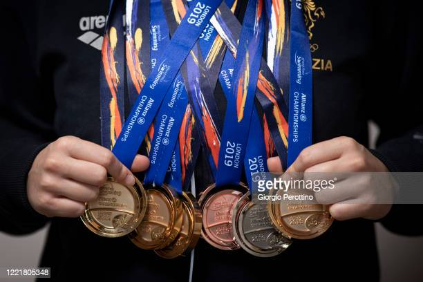 Paralympic swimmer Carlotta Gilli, current world champion in S13 category, shows her medals before training in isolation on April 29, 2020 in Turin,...
