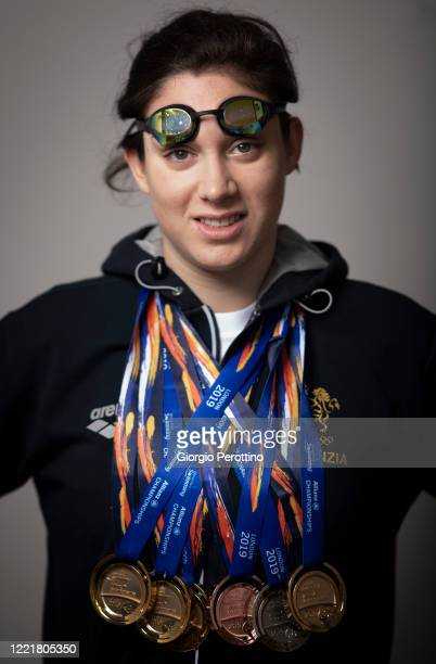 Paralympic swimmer Carlotta Gilli current world champion in S13 category shows her medals before training in isolation on April 29 2020 in Turin...