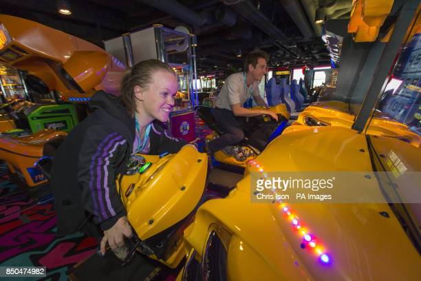 Paralympic swimmer Ellie Simmonds and Chris Cook former Olympic swimmer and Just a Drop School Ambassador relax in the Video Arcade on board...