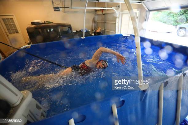 Paralympic swimmer McKenzie Coan works out in a tethered resistance pool during a training session on June 09, 2020 in Clarkesville, United States....
