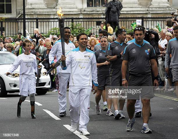 A paralympic torchbearer carries the Paralympic Torch in Trafalgar Square ahead of the start of the London 2012 Paraympic Games on August 29 in...