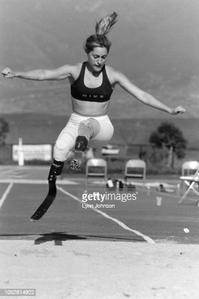 Portrait of double amputee and runner Aimee Mullins in action long jump with artificial legs during practice Prosthetic legs London England 2/2/1997...