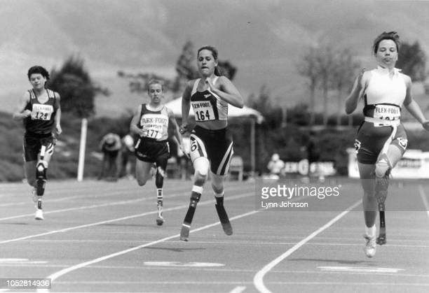 View of double amputee and runner Aimee Mullins in action during 100M race Prosthetic legs London England 2/2/1997 CREDIT Lynn Johnson