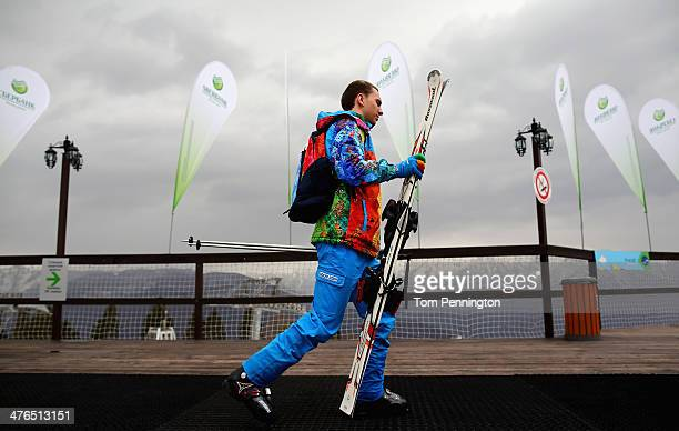 Paralympic volunteer walks to the ski lift at the Gornaya Karusel ski area on March 3 2014 ahead of the 2014 Paralympic Winter Games in Sochi Russia
