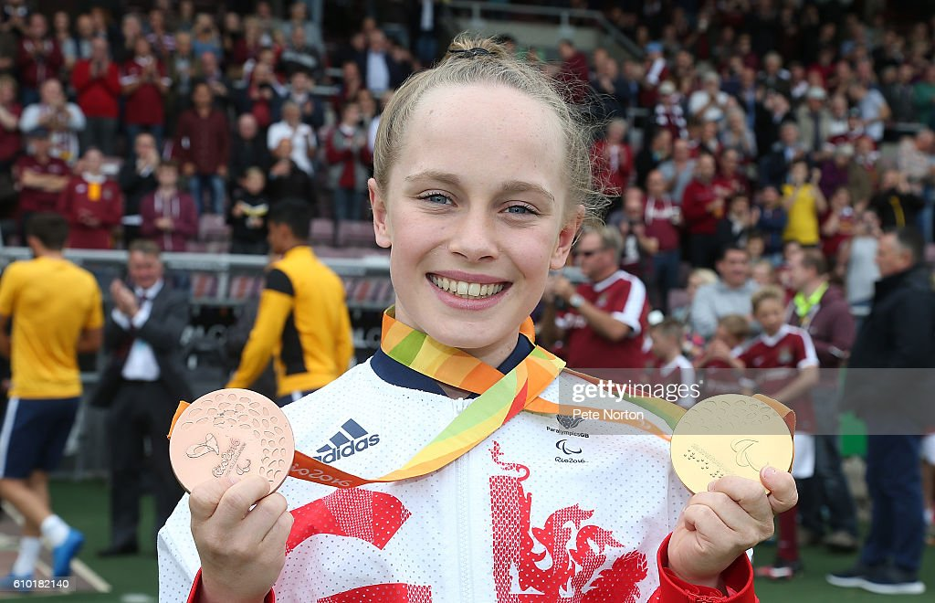 GB Paralympics Swimmer Ellie Robinson poses with her 50m butterfly Gold Medel and her 100m freestyle Bronze Medel she won at the 2016 Rio Paralympics prior to the Sky Bet League One match between Northampton Town and Southend United at Sixfields on September 24, 2016 in Northampton, England.