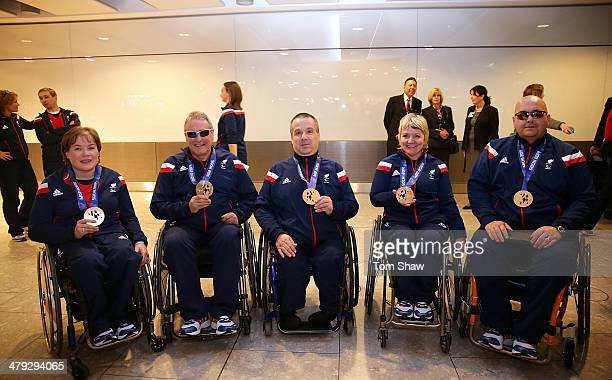 ParalympicsGB curlers Aileen Neilson Jim Gault Bob McPherson Angie Malone and Gregor Ewan show off their medals during the ParalympicsGB Welcome Home...