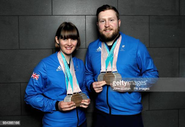 ParalympicsGB's Millie Knight and guide Brett Wild poses with their Bronze and 2 Silver medals as the team arrive at Heathrow Airport London...