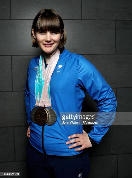 ParalympicsGB's Millie Knight poses with her Bronze and 2 Silver medals as the team arrive at Heathrow Airport London following the PyeongChang 2018...