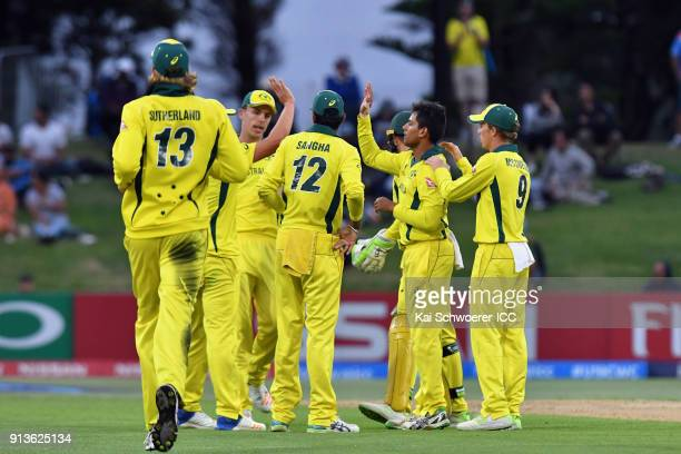 Param Uppal of Australia is congratulated by team mates after dismissing Shubman Gill of India during the ICC U19 Cricket World Cup Final match...