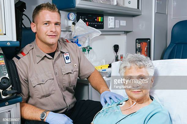 Paramedic and patient in ambulance, portrait