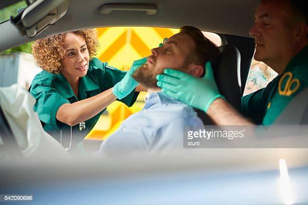 paramedic at the scene of a car crash