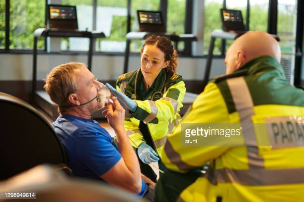 paramedic at the scene - ambulance stock pictures, royalty-free photos & images