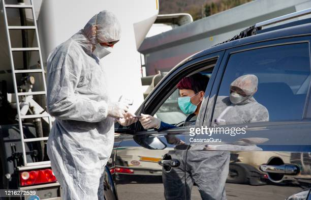 paramedic controlling population health who are leaving the house during coronavirus quarantine - essential workers stock pictures, royalty-free photos & images