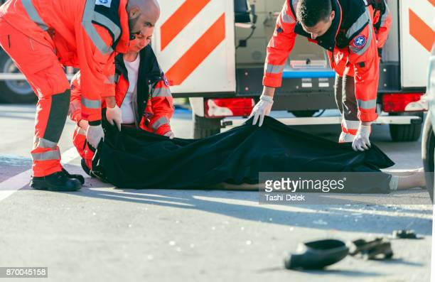 paramedic coved dead body - of dead people in car accidents stock pictures, royalty-free photos & images