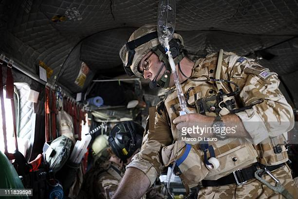 Paramedic CPL Tony Stephens, 37-years-old from the RAF Lyneham 4626 Squadron check on board of the MERT CH-47 Chinook the fluids as the MERT Team fly...