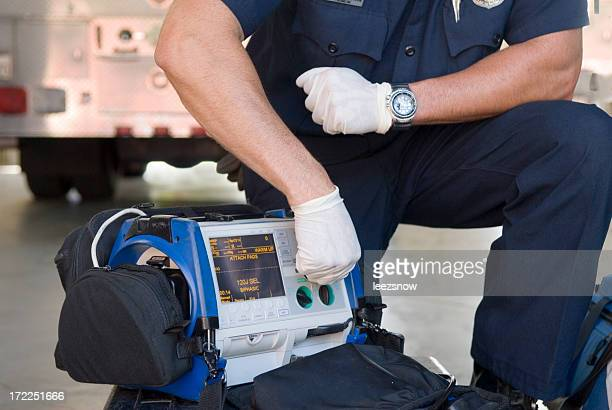 Paramedic Demonstrating a Portable Defibrillator