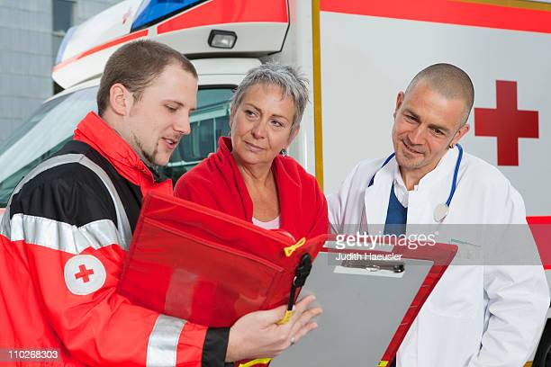 Paramedic doctor and patient examining