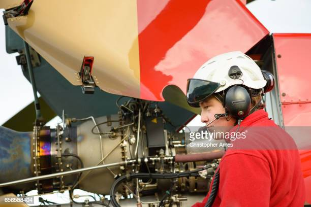 Paramedic Helicopter Crew Checks the Aircraft's Engine