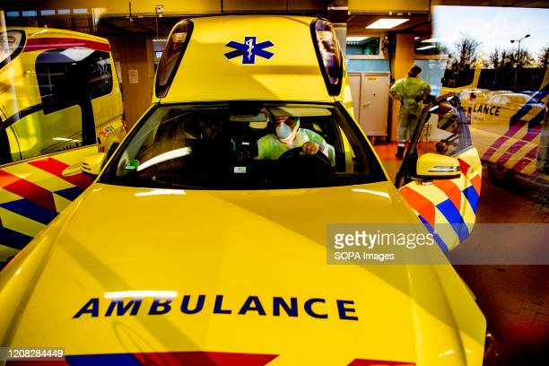 Paramedic inside an ambulance seen ready to transfer patients from the Elisabeth-TweeSteden Hospital in Tilburg due to overload amid Coronavirus...