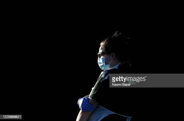 Paramedic is seen wearing PPE as she waits outside an ambulance to monitor an incident at on May 19, 2020 in Lee-On-The-Solent, England. The British...