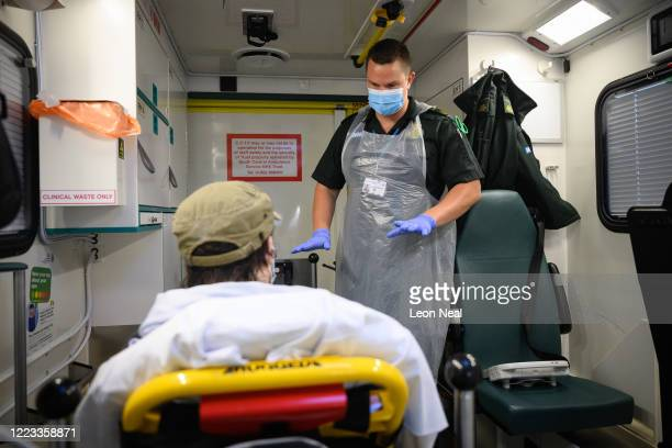 Paramedic James Hansford treats a patient who has previously tested positive for the COVID-19 virus for a separate issue, after responding to a 999...
