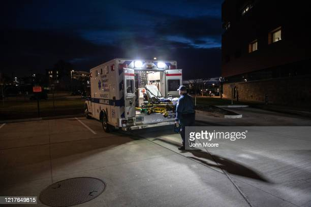 A paramedic loads a cleaned stretcher onto the back of an ambulance before heading out for another call on April 02 2020 in Stamford Connecticut...