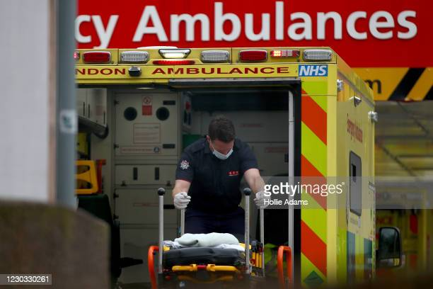 Paramedic moves a stretcher inside an ambulance at St Thomas' Hospital on December 28, 2020 in London, United Kingdom. Patient demand for the London...