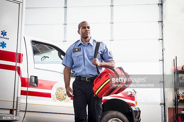 Paramedic next to ambulance