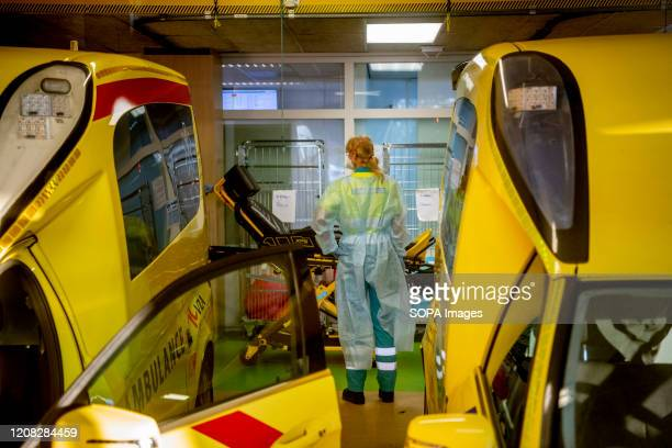 Paramedic next to an ambulance seen ready to transfer patients from the Elisabeth-TweeSteden Hospital in Tilburg due to overload amid Coronavirus...
