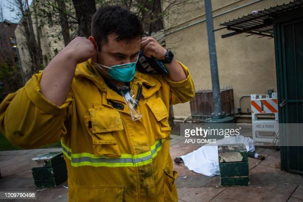 TOPSHOT Paramedic of the LAFD Station No9 wears a N95 mask as a preventive measure against the spread of the COVID19 novel coronavirus with a the...