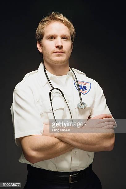 Paramedic on black background, portrait