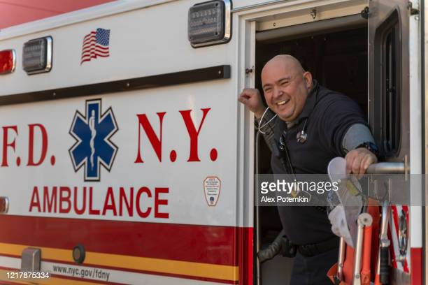 paramedic on duty waiting for a call in ambulance vehicle in a garage of queens hospital center during the covid-19 pandemic. - alex potemkin coronavirus stock pictures, royalty-free photos & images