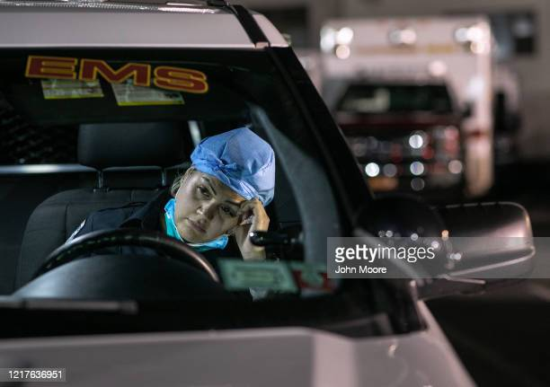 Paramedic Patricia Rodriguez fills out reports on a laptop after her 12hour shift on April 06 2020 in Yonkers New York Empress EMS paramedics and...