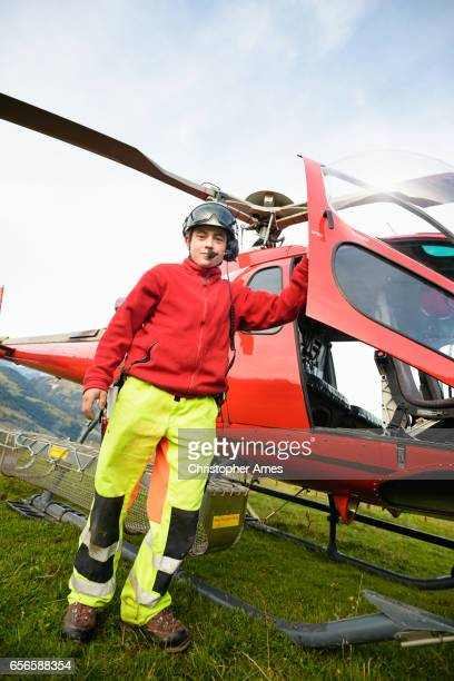 Paramedic Poses with Mountain Rescue Helicopter