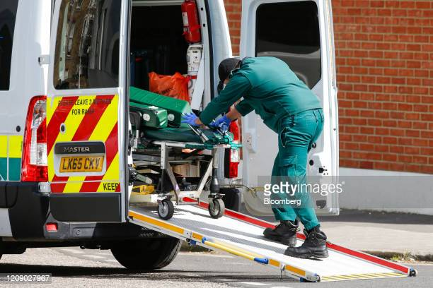 A paramedic pushes a stretcher into an ambulance near King's College Hospital operated by the King's College Hospital NHS foundation trust in London...
