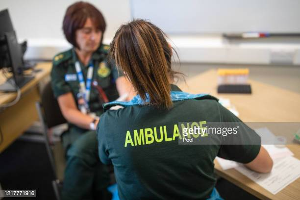 Paramedic, right, takes a blood sample from a medical worker, during an antibody testing program at the Hollymore Ambulance Hub of the West Midlands...