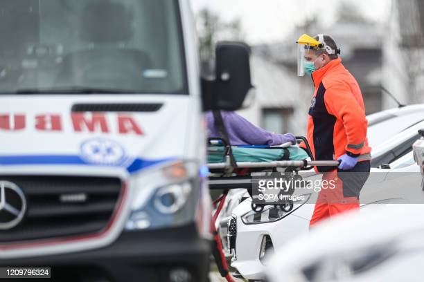 Paramedic seen wearing a face shield as well as a facemask as protective measure against the COVID-19 coronavirus as he takes a patient to the...