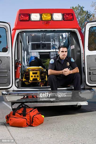 Paramedic sitting in back of ambulance