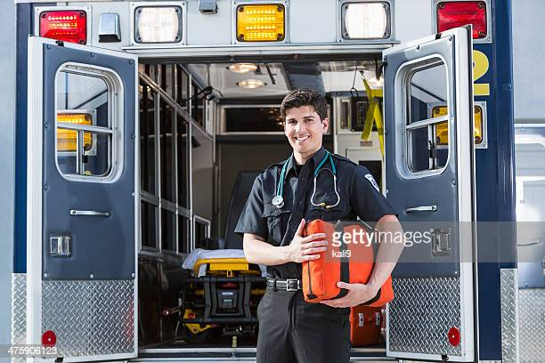 Paramedic standing by ambulance