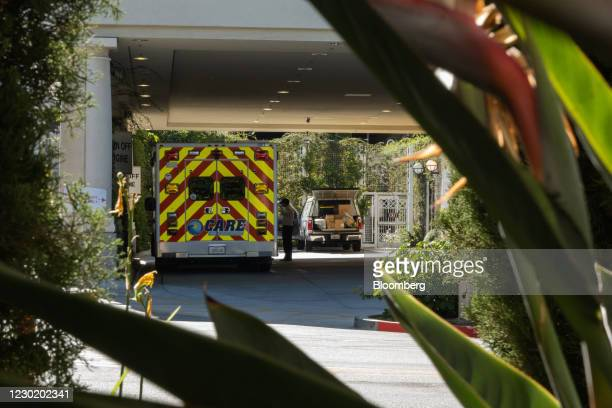 Paramedic stands next to an ambulance at Huntington Hospital in Pasadena, California, U.S., on Friday, Dec. 18, 2020. Greater Los Angeles is emerging...