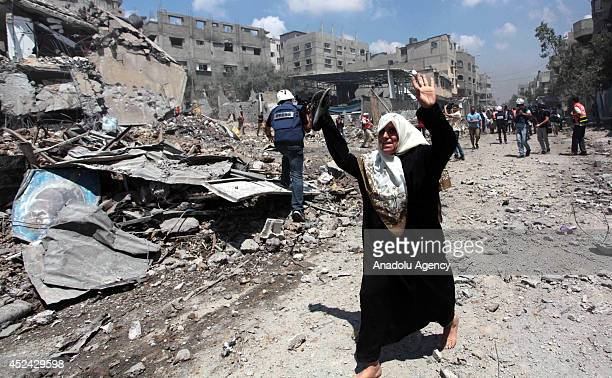 Paramedic team and few journalists access to the Shujaya neighborhood of Gaza during the twohour humanitarian ceasefire proposal from the...