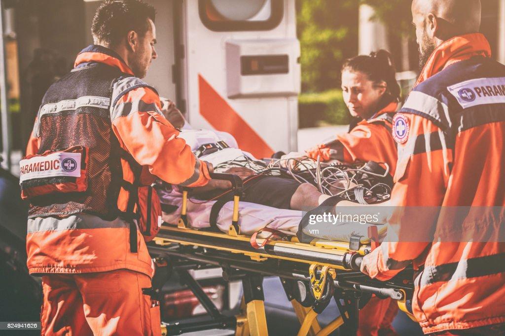 Paramedic team helping injured person : Stock Photo